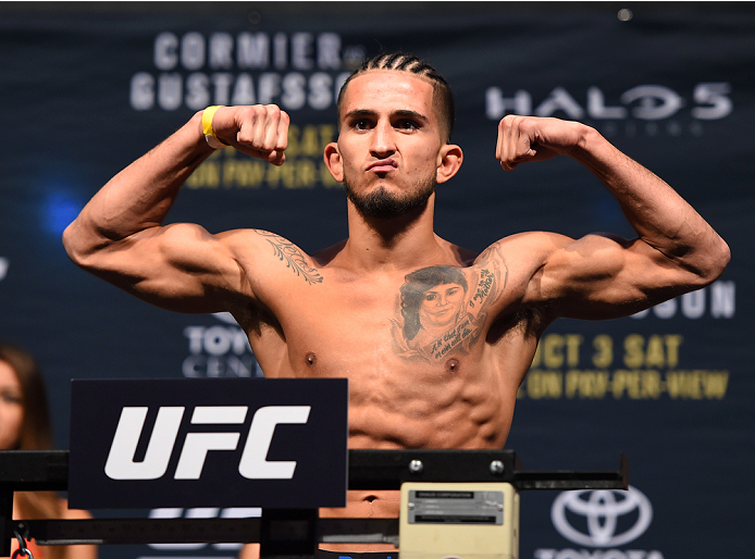 HOUSTON, TX - OCTOBER 02:  Sergio Pettis steps on the scale during the UFC 192 weigh-in at the Toyota Center on October 2, 2015 in Houston, Texas. (Photo by Josh Hedges/Zuffa LLC/Zuffa LLC via Getty Images)