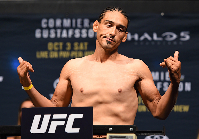 HOUSTON, TX - OCTOBER 02:  Francisco Trevino steps on the scale during the UFC 192 weigh-in at the Toyota Center on October 2, 2015 in Houston, Texas. (Photo by Josh Hedges/Zuffa LLC/Zuffa LLC via Getty Images)