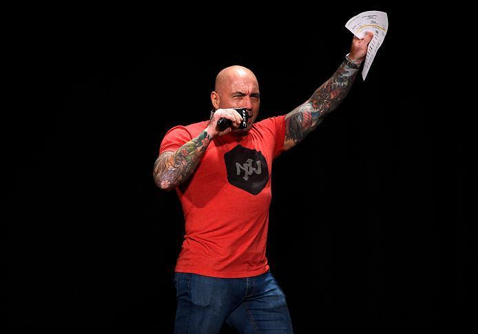 ATLANTA, GA - JULY 29:  UFC commentator Joe Rogan walks onto the stage before the UFC 201 weigh-in at Fox Theatre on July 29, 2016 in Atlanta, Georgia. (Photo by Jeff Bottari/Zuffa LLC/Zuffa LLC via Getty Images)
