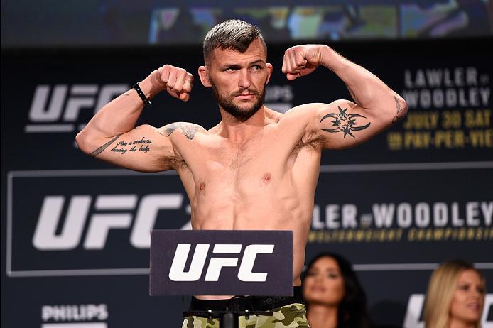 ATLANTA, GA - JULY 29:  Damian Brown of Australia steps on the scale during the UFC 201 weigh-in at Fox Theatre on July 29, 2016 in Atlanta, Georgia. (Photo by Jeff Bottari/Zuffa LLC/Zuffa LLC via Getty Images)