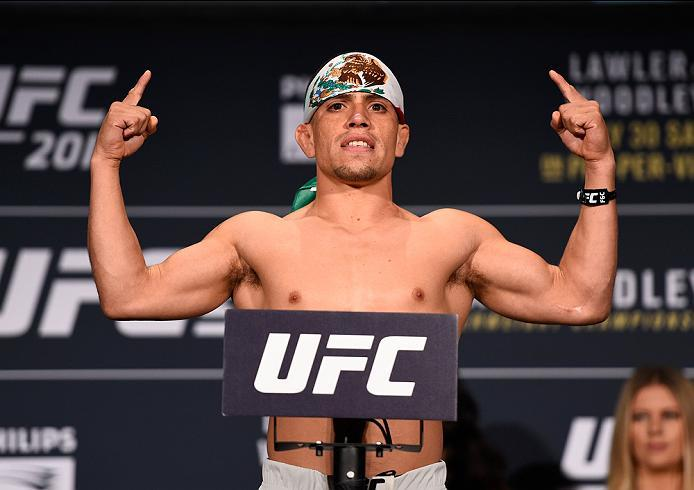 ATLANTA, GA - JULY 29:  Hector Sandoval of Mexico steps on the scale during the UFC 201 weigh-in at Fox Theatre on July 29, 2016 in Atlanta, Georgia. (Photo by Jeff Bottari/Zuffa LLC/Zuffa LLC via Getty Images)