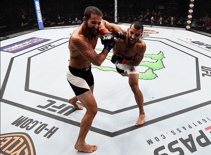 SIOUX FALLS, SD - JULY 13:   (R-L) Devin Clark elbows Alex Nicholson in their middleweight bout during the UFC Fight Night event on July 13, 2016 at Denny Sanford Premier Center in Sioux Falls, South Dakota. (Photo by Jeff Bottari/Zuffa LLC/Zuffa LLC via