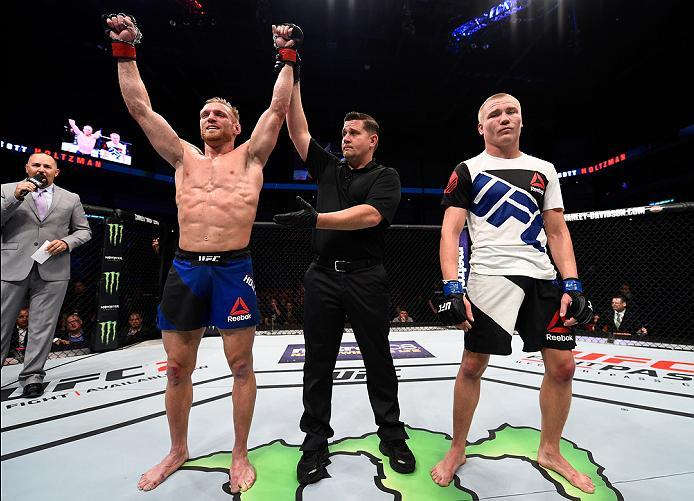 SIOUX FALLS, SD - JULY 13:   Scott Holtzman (L) celebrates after his decision victory over Cody Pfister in their lightweight bout during the UFC Fight Night event on July 13, 2016 at Denny Sanford Premier Center in Sioux Falls, South Dakota. (Photo by Jef