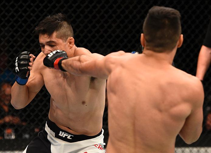 LAS VEGAS, NV - JULY 07:   (R-L) Vicente Luque of the United States and Alvaro Herrera of Mexico trade punches in their welterweight bout during the UFC Fight Night event inside the MGM Grand Garden Arena on July 7, 2016 in Las Vegas, Nevada. (Photo by Je