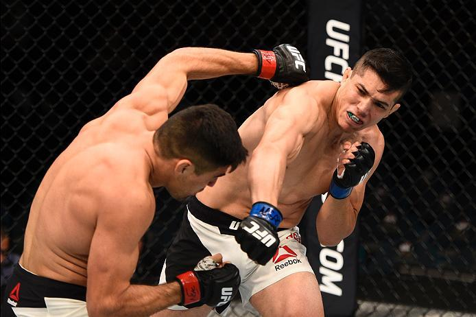 LAS VEGAS, NV - JULY 07:   (R-L) Alvaro Herrera of Mexico punches Vicente Luque in their welterweight bout during the UFC Fight Night event inside the MGM Grand Garden Arena on July 7, 2016 in Las Vegas, Nevada. (Photo by Jeff Bottari/Zuffa LLC/Zuffa LLC