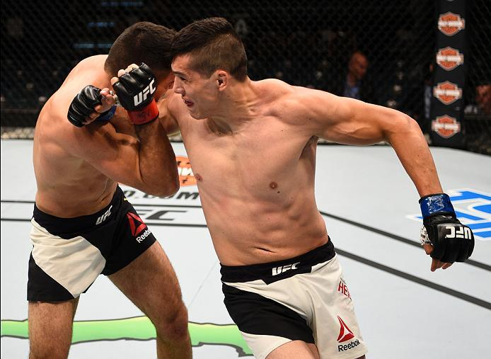 LAS VEGAS, NV - JULY 07:   (R-L) Alvaro Herrera of Mexico lands a spinning back elbow against Vicente Luque in their welterweight bout during the UFC Fight Night event inside the MGM Grand Garden Arena on July 7, 2016 in Las Vegas, Nevada. (Photo by Jeff