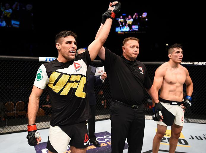 LAS VEGAS, NV - JULY 07:   Vicente Luque celebrates after his submission victory over Alvaro Herrera of Mexico in their welterweight bout during the UFC Fight Night event inside the MGM Grand Garden Arena on July 7, 2016 in Las Vegas, Nevada. (Photo by Je