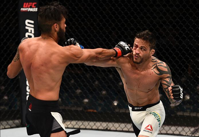 LAS VEGAS, NV - JULY 07:   (R-L) Reginaldo Vieira of Brazil and Marco Beltran of Mexico trade punches in their bantamweight bout during the UFC Fight Night event inside the MGM Grand Garden Arena on July 7, 2016 in Las Vegas, Nevada. (Photo by Jeff Bottar