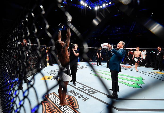 ROTTERDAM, NETHERLANDS - MAY 08:  (L-R) Willie Gates is introduced by Bruce Buffer before facing Ulka Sasaki in their flyweight bout during the UFC Fight Night event at Ahoy Rotterdam on May 8, 2016 in Rotterdam, Netherlands. (Photo by Josh Hedges/Zuffa L