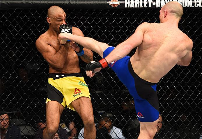 BROOKLYN, NEW YORK - FEBRUARY 11:  (R-L) Ryan LaFlare kicks Roan Carneiro of Brazil in their welterweight bout during the UFC 208 event inside Barclays Center on February 11, 2017 in Brooklyn, New York. (Photo by Jeff Bottari/Zuffa LLC/Zuffa LLC via Getty