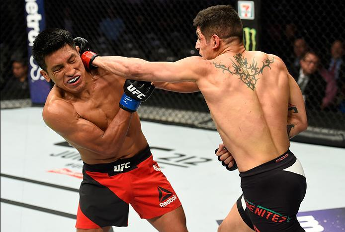 DALLAS, TX - MAY 13:  (R-L) Gabriel Benitez punches Enrique Barzola in their featherweight fight during the UFC 211 event at the American Airlines Center on May 13, 2017 in Dallas, Texas. (Photo by Josh Hedges/Zuffa LLC/Zuffa LLC via Getty Images)