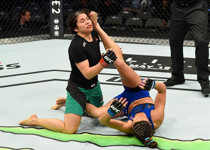 DALLAS, TX - MAY 13:  (R-L) Cortney Casey up-kicks Jessica Aguilar in their women's strawweight fight during the UFC 211 event at the American Airlines Center on May 13, 2017 in Dallas, Texas. (Photo by Josh Hedges/Zuffa LLC/Zuffa LLC via Getty Images)