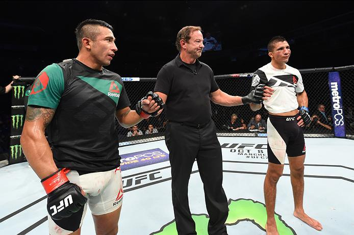HIDALGO, TX - SEPTEMBER 17:   (R-L) Albert Morales and Alejandro Perez of Mexico react to their majority draw decision after their bantamweight bout during the UFC Fight Night event at State Farm Arena on September 17, 2016 in Hidalgo, Texas. (Photo by Jo