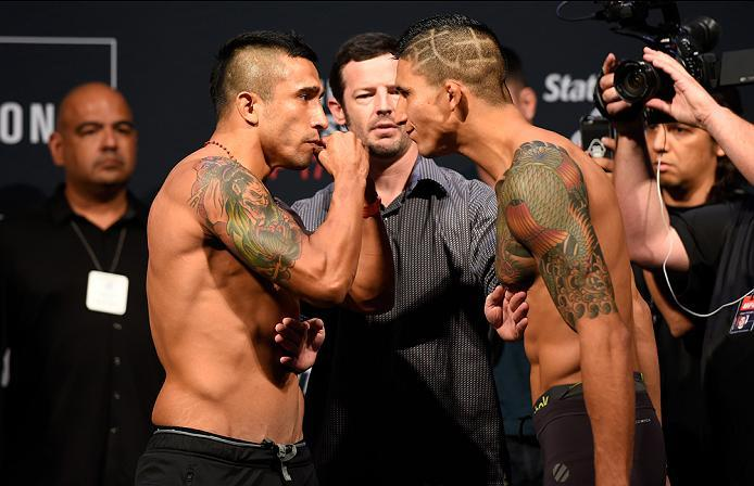 HIDALGO, TX - SEPTEMBER 16:  (L-R) Alejandro Perez of Mexico and Albert Morales of the United States face off during the UFC Fight Night weigh-in at the State Farm Arena on September 16, 2016 in Hidalgo, Texas. (Photo by Josh Hedges/Zuffa LLC/Zuffa LLC vi