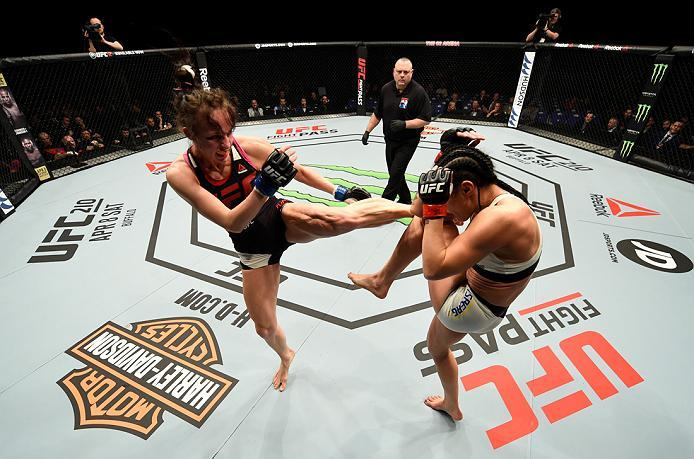 LONDON, ENGLAND - MARCH 18:  (L-R) Lucie Pudilova of the Czech Republic kicks Lina Lansberg of Sweden in their women's bantamweight fight during the UFC Fight Night event at The O2 arena on March 18, 2017 in London, England. (Photo by Josh Hedges/Zuffa LL