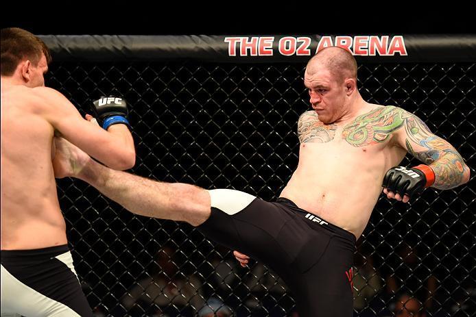 LONDON, ENGLAND - MARCH 18:  (R-L) Bradley Scott of England kicks Scott Askham of England in their middleweight fight during the UFC Fight Night event at The O2 arena on March 18, 2017 in London, England. (Photo by Josh Hedges/Zuffa LLC/Zuffa LLC via Gett