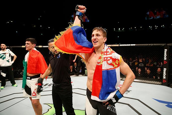 ZAGREB, CROATIA - APRIL 10:   (R-L) Bojan Velickovic celebrates his submission victory over Alessio Di Chirico  in their middleweight bout during the UFC Fight Night event at the Arena Zagreb on April 10, 2016 in Zagreb, Croatia. (Photo by Srdjan Stevanov