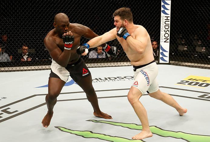 ZAGREB, CROATIA - APRIL 10:   (R-L) Cyril Asker punches Jared Cannonier in their heavyweight bout during the UFC Fight Night event at the Arena Zagreb on April 10, 2016 in Zagreb, Croatia. (Photo by Srdjan Stevanovic/Zuffa LLC/Zuffa LLC via Getty Images)