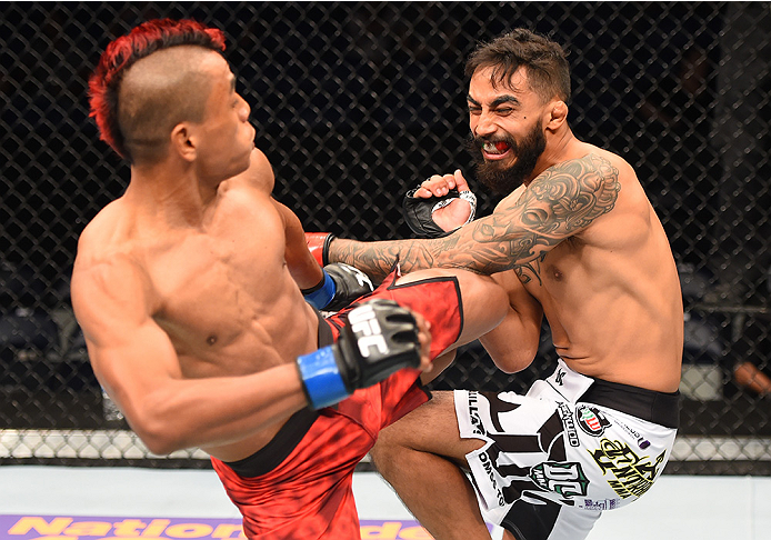 NEW ORLEANS, LA - JUNE 06:  Leonardo Morales kicks Jose Quinonez in their bantamweight bout during the UFC event at the Smoothie King Center on June 6, 2015 in New Orleans, Louisiana. (Photo by Josh Hedges/Zuffa LLC/Zuffa LLC via Getty Images)