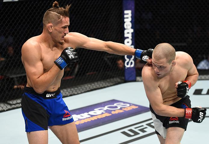 HOUSTON, TX - FEBRUARY 04:  (L-R) Niko Price punches Alex Morono in their welterweight bout during the UFC Fight Night event at the Toyota Center on February 4, 2017 in Houston, Texas. (Photo by Jeff Bottari/Zuffa LLC/Zuffa LLC via Getty Images)