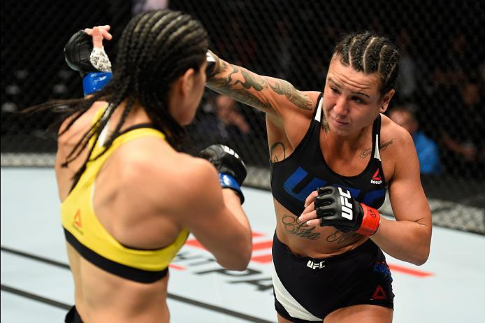 KANSAS CITY, MO - APRIL 15:  (R-L) Ashlee Evans-Smith punches Ketlen Vieira of Brazil in their women's bantamweight fight during the UFC Fight Night event at Sprint Center on April 15, 2017 in Kansas City, Missouri. (Photo by Josh Hedges/Zuffa LLC/Zuffa L