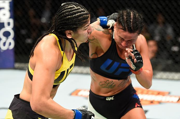 KANSAS CITY, MO - APRIL 15:  (R-L) Ashlee Evans-Smith exchanges punches with Ketlen Vieira of Brazil in their women's bantamweight fight during the UFC Fight Night event at Sprint Center on April 15, 2017 in Kansas City, Missouri. (Photo by Josh Hedges/Zu