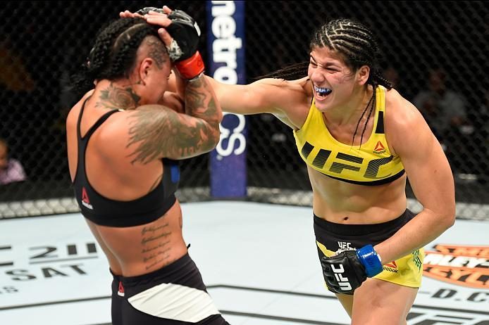 KANSAS CITY, MO - APRIL 15:  (R-L) Ketlen Vieira of Brazil punches Ashlee Evans-Smith in their women's bantamweight fight during the UFC Fight Night event at Sprint Center on April 15, 2017 in Kansas City, Missouri. (Photo by Josh Hedges/Zuffa LLC/Zuffa L