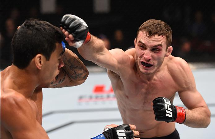 NEWARK, NJ - JANUARY 30:  (R-L) Tony Martin punches Felipe Olivieri in their lightweight bout during the UFC Fight Night event at the Prudential Center on January 30, 2016 in Newark, New Jersey. (Photo by Josh Hedges/Zuffa LLC/Zuffa LLC via Getty Images)