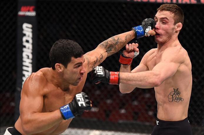 NEWARK, NJ - JANUARY 30:  (L-R) Felipe Olivieri punches Tony Martin in their lightweight bout during the UFC Fight Night event at the Prudential Center on January 30, 2016 in Newark, New Jersey. (Photo by Josh Hedges/Zuffa LLC/Zuffa LLC via Getty Images)