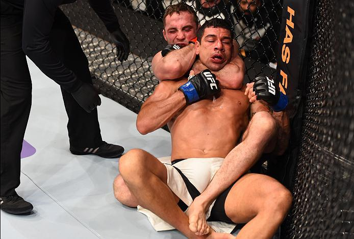 NEWARK, NJ - JANUARY 30:  (L-R) Tony Martin submits Felipe Olivieri in their lightweight bout during the UFC Fight Night event at the Prudential Center on January 30, 2016 in Newark, New Jersey. (Photo by Josh Hedges/Zuffa LLC/Zuffa LLC via Getty Images)