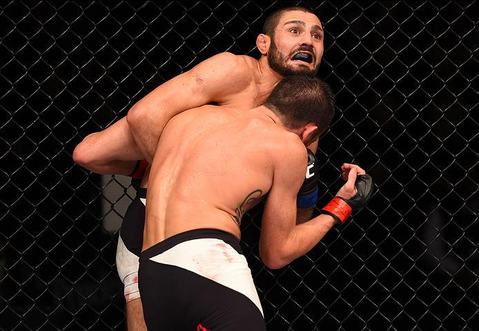 NEWARK, NJ - JANUARY 30:  (R-L) Levan Makashvili is pushed up against the cage by Damon Jackson in their featherweight bout during the UFC Fight Night event at the Prudential Center on January 30, 2016 in Newark, New Jersey. (Photo by Josh Hedges/Zuffa LL