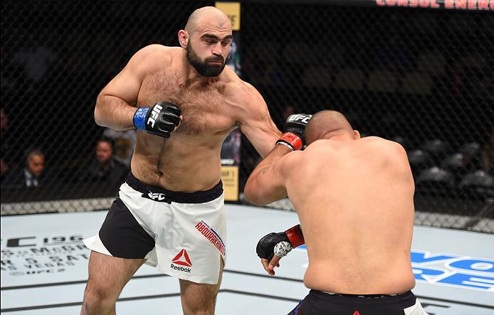 PITTSBURGH, PA - FEBRUARY 21:  (L-R) Shamil Abdurakhimov punches Anthony Hamilton in their heavyweight bout during the UFC Fight Night event at Consol Energy Center on February 21, 2016 in Pittsburgh, Pennsylvania. (Photo by Jeff Bottari/Zuffa LLC/Zuffa L