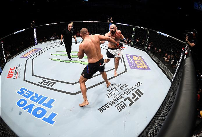 PITTSBURGH, PA - FEBRUARY 21:  (R-L) Shamil Abdurakhimov punches Anthony Hamilton in their heavyweight bout during the UFC Fight Night event at Consol Energy Center on February 21, 2016 in Pittsburgh, Pennsylvania. (Photo by Jeff Bottari/Zuffa LLC/Zuffa L