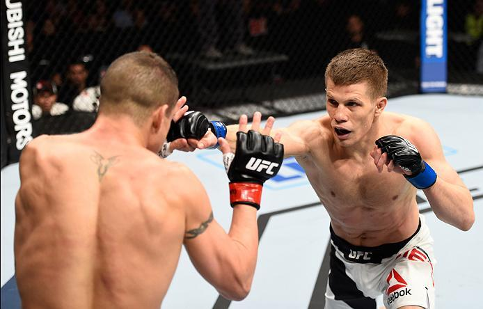 MEXICO CITY, MEXICO - NOVEMBER 05:  (R-L) Marcin Held of Poland punches Diego Sanchez of the United States in their lightweight bout during the UFC Fight Night event at Arena Ciudad de Mexico on November 5, 2016 in Mexico City, Mexico. (Photo by Jeff Bott