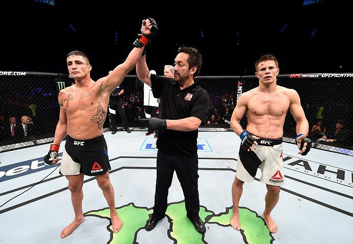 MEXICO CITY, MEXICO - NOVEMBER 05:  (L-R) Diego Sanchez of the United States celebrates his victory over Marcin Held of Poland in their lightweight bout during the UFC Fight Night event at Arena Ciudad de Mexico on November 5, 2016 in Mexico City, Mexico.