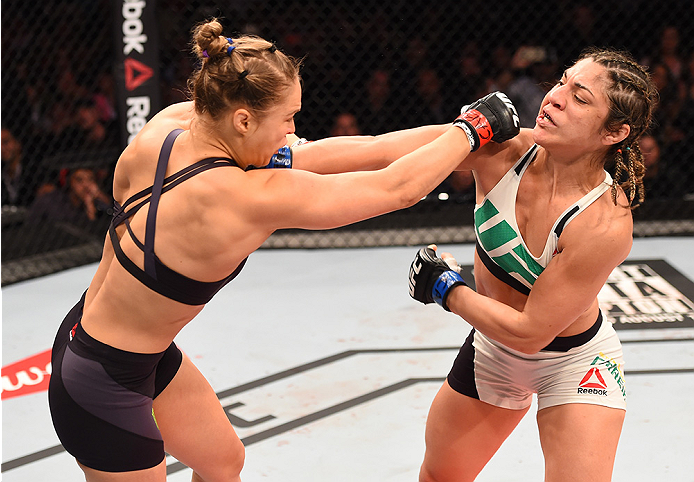RIO DE JANEIRO, BRAZIL - AUGUST 01:  (L-R) Ronda Rousey of the United States punches Bethe Correia of Brazil in their UFC women's bantamweight championship bout during the UFC 190 event inside HSBC Arena on August 1, 2015 in Rio de Janeiro, Brazil.  (Phot