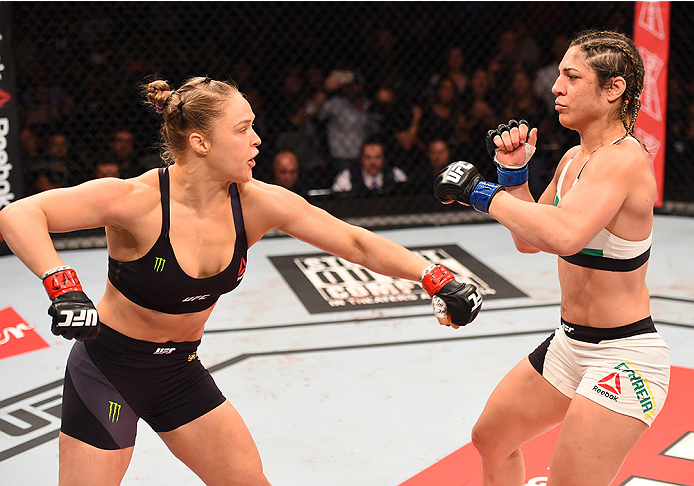 RIO DE JANEIRO, BRAZIL - AUGUST 01:  (L-R) Ronda Rousey of the United States throws a punch at Bethe Correia of Brazil in their UFC women's bantamweight championship bout during the UFC 190 event inside HSBC Arena on August 1, 2015 in Rio de Janeiro, Braz