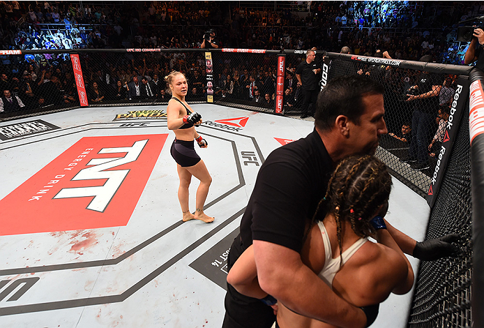 RIO DE JANEIRO, BRAZIL - AUGUST 01:  (L-R) Ronda Rousey of the United States knocks out Bethe Correia of Brazil in the first round in their UFC women's bantamweight championship bout during the UFC 190 event inside HSBC Arena on August 1, 2015 in Rio de J