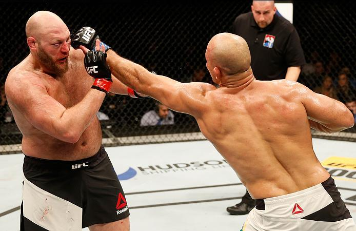ZAGREB, CROATIA - APRIL 10:   (R-L) Junior Dos Santos punches Ben Rothwell in their heavyweight bout during the UFC Fight Night event at the Arena Zagreb on April 10, 2016 in Zagreb, Croatia. (Photo by Srdjan Stevanovic/Zuffa LLC/Zuffa LLC via Getty Image