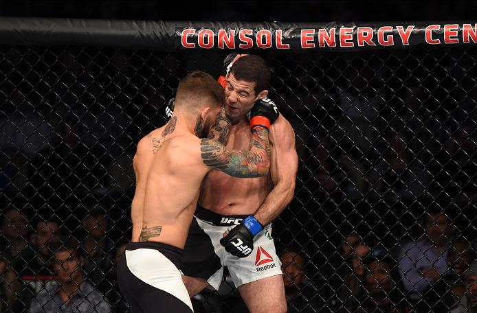 PITTSBURGH, PA - FEBRUARY 21:  (L-R) Cody Garbrandt punches Augusto Mendes in their bantamweight bout during the UFC Fight Night event at Consol Energy Center on February 21, 2016 in Pittsburgh, Pennsylvania. (Photo by Jeff Bottari/Zuffa LLC/Zuffa LLC via