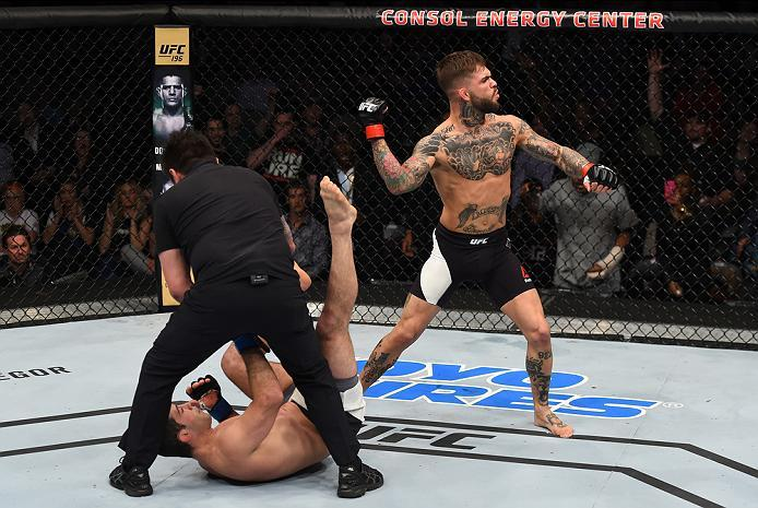 PITTSBURGH, PA - FEBRUARY 21:  (R-L) Cody Garbrandt celebrates his knockout victory over Augusto Mendes in their bantamweight bout during the UFC Fight Night event at Consol Energy Center on February 21, 2016 in Pittsburgh, Pennsylvania. (Photo by Jeff Bo
