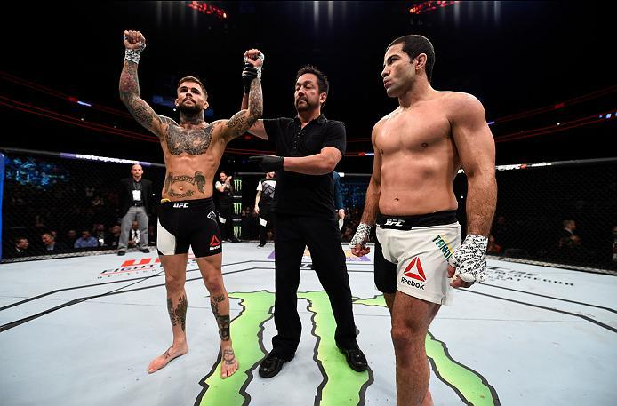 PITTSBURGH, PA - FEBRUARY 21:  (L-R) Cody Garbrandt celebrates his knockout victory over Augusto Mendes in their bantamweight bout during the UFC Fight Night event at Consol Energy Center on February 21, 2016 in Pittsburgh, Pennsylvania. (Photo by Jeff Bo