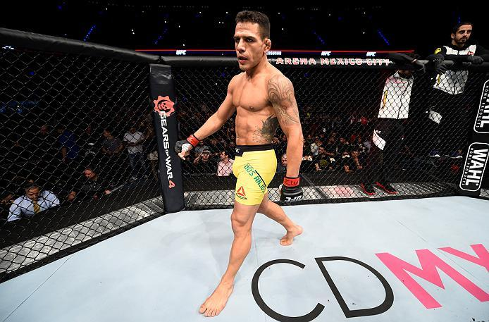 MEXICO CITY, MEXICO - NOVEMBER 05:  Rafael Dos Anjos of Brazil enters the Octagon before facing Tony Ferguson of the United States  in their lightweight bout during the UFC Fight Night event at Arena Ciudad de Mexico on November 5, 2016 in Mexico City, Me