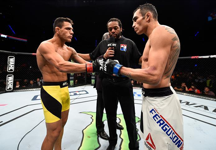 MEXICO CITY, MEXICO - NOVEMBER 05:  (R-L) Tony Ferguson of the United States and Rafael Dos Anjos of Brazil touch gloves in their lightweight bout during the UFC Fight Night event at Arena Ciudad de Mexico on November 5, 2016 in Mexico City, Mexico. (Phot