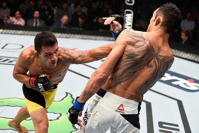 MEXICO CITY, MEXICO - NOVEMBER 05:  (L-R) Rafael Dos Anjos of Brazil punches Tony Ferguson of the United States in their lightweight bout during the UFC Fight Night event at Arena Ciudad de Mexico on November 5, 2016 in Mexico City, Mexico. (Photo by Jeff