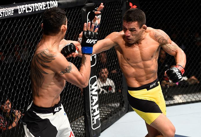 MEXICO CITY, MEXICO - NOVEMBER 05:  (R-L) Rafael Dos Anjos of Brazil throws a spinning back fist at Tony Ferguson of the United States in their lightweight bout during the UFC Fight Night event at Arena Ciudad de Mexico on November 5, 2016 in Mexico City,