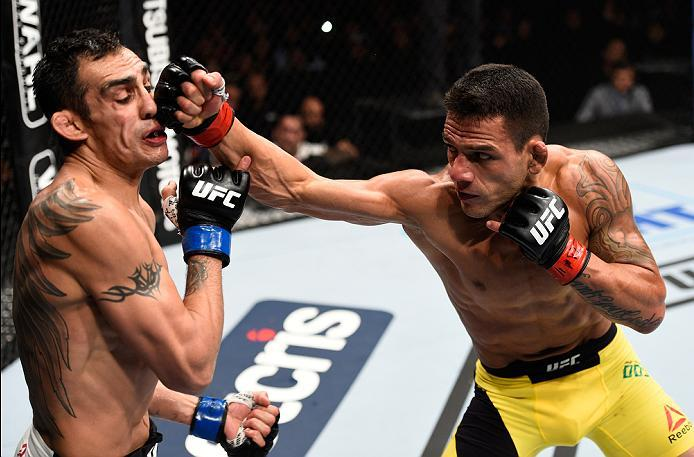 MEXICO CITY, MEXICO - NOVEMBER 05:  (R-L) Rafael Dos Anjos of Brazil punches Tony Ferguson of the United States in their lightweight bout during the UFC Fight Night event at Arena Ciudad de Mexico on November 5, 2016 in Mexico City, Mexico. (Photo by Jeff