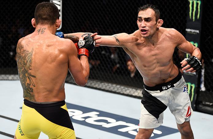 MEXICO CITY, MEXICO - NOVEMBER 05:  (R-L) Tony Ferguson of the United States punches Rafael Dos Anjos of Brazil in their lightweight bout during the UFC Fight Night event at Arena Ciudad de Mexico on November 5, 2016 in Mexico City, Mexico. (Photo by Jeff
