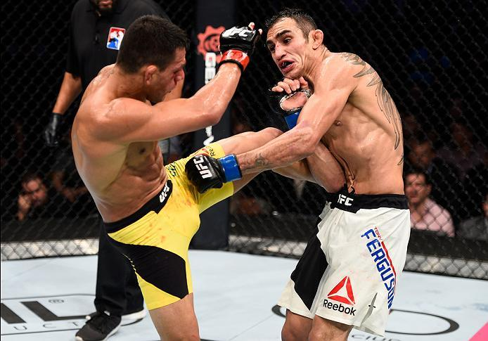 MEXICO CITY, MEXICO - NOVEMBER 05:  (L-R) Rafael Dos Anjos of Brazil kicks Tony Ferguson of the United States in their lightweight bout during the UFC Fight Night event at Arena Ciudad de Mexico on November 5, 2016 in Mexico City, Mexico. (Photo by Jeff B