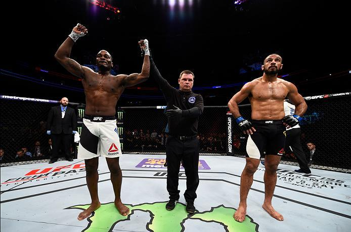 PITTSBURGH, PA - FEBRUARY 21:  (L-R) Derek Brunson celebrates his knockout victory over Roan Carneiro in their middleweight bout during the UFC Fight Night event at Consol Energy Center on February 21, 2016 in Pittsburgh, Pennsylvania. (Photo by Jeff Bott